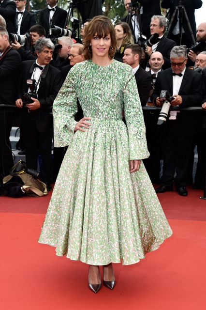 Celine Sallette wore a printed Green white and black silk faille coat-Dior-Haute-Couture Bois de Rose earrings by Dior Fine Jewelry Getty Images for Dior