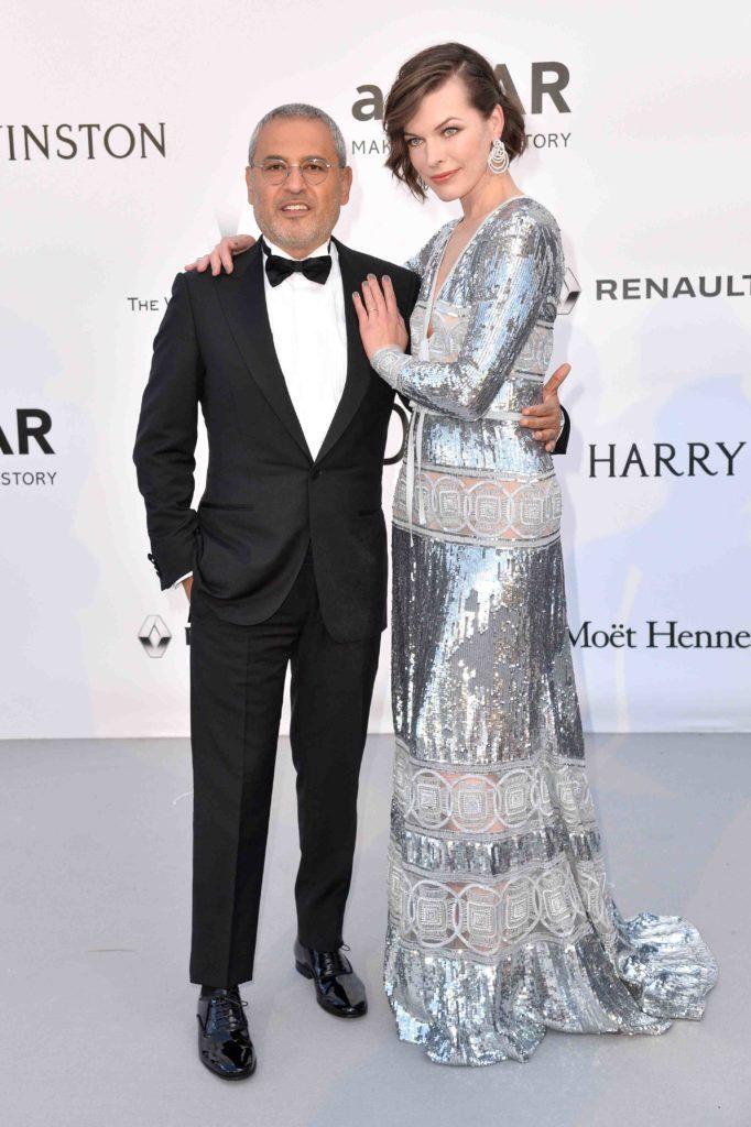 Elie Saab and Milla Jovovich at amfAR the 69th annual Cannes Film Festival