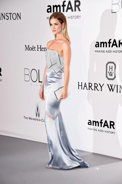 Rosie Huntington-Whiteley sparkled in a silver lizard skin Serpenti evening clutch.