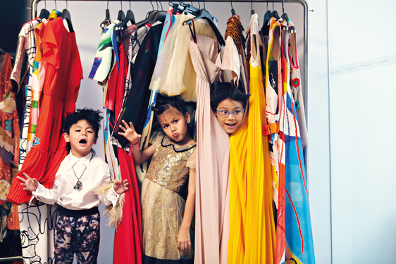 Mika, Maya, and Max all hyped up from their mother's vivid designs