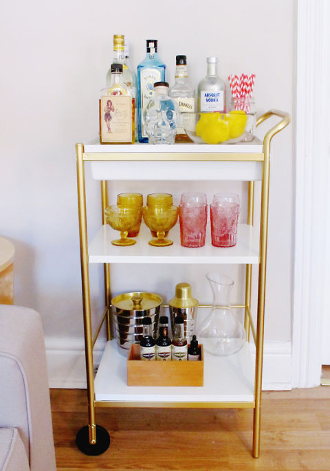 Most glassware you'll find is devoid of color, but taking the time to find a few statement pieces in brighter hues will instantly make your bar cart stand apart from the others. We love the pink and yellow glasses in this bar cart belonging to Leslie Martin of See Love Covet. Photography: Leslie Martin