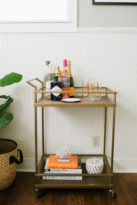 If an overly-styled look isn't for you, here's an idea: Taylor Sterling of Glitter Guide masterfully created this simplistic vignette by limiting the liquor bottles to one corner and using the rest of the cart to show off beautiful books and knick knacks. Brilliant. Photography: Delbarr Moradi
