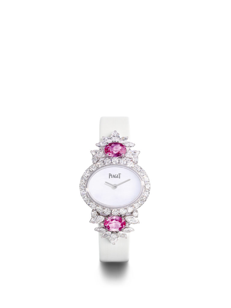 18K white gold watch with white satin strap. Additional black satin strap available.