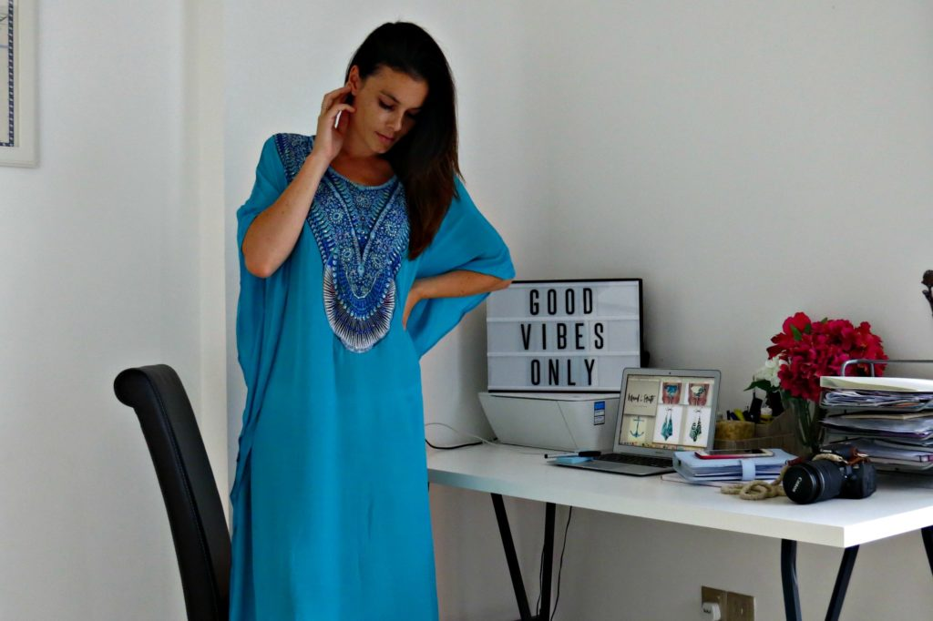 Founder and Creative Director of Island State Swimwear, Jenna Milne wears her latest resort wear line of caftans, Palma
