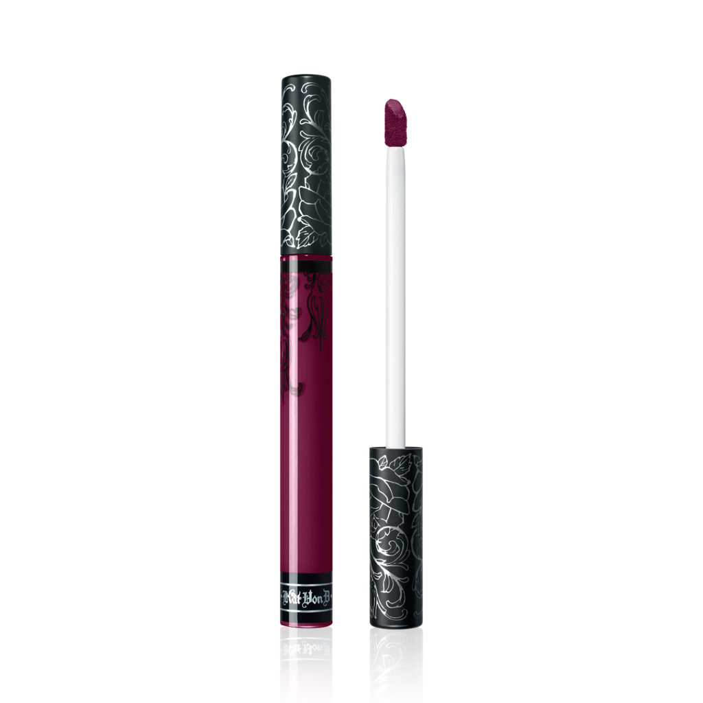 The iconic Kat Von D Beauty Everlasting Liquid Lipstick in Exorcism, a majestic plum shade