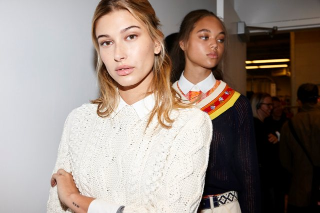 Kendal created faux freckles by drawing them on with brown eyeliner and patting them into the skin for a natural fade; as seen here on Hailey Baldwin.