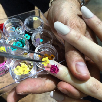 Sacripante applies a mini bouquet to a single nail at Antonio Marras Autumn/Winter'16