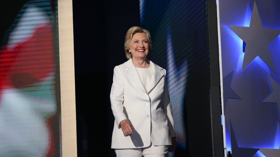 Hillary Clinton, 2016 Democratic presidential nominee, smiles while arriving on stage during the Democratic National Convention (DNC) in Philadelphia, Pennsylvania, U.S., on Thursday, July 28, 2016. Division among Democrats has been overcome through speeches from two presidents, another first lady and a vice-president, who raised the stakes for their candidate by warning that her opponent posed an unprecedented threat to American diplomacy. Photographer: Daniel Acker/Bloomberg via Getty Images