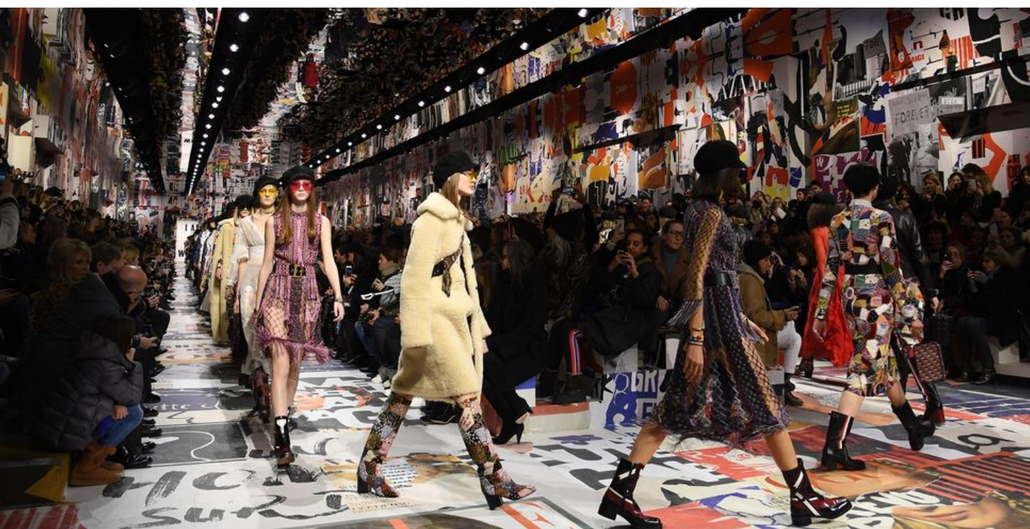 Dior Staged A 1960s Protest Down Its Fall 2018 Runway