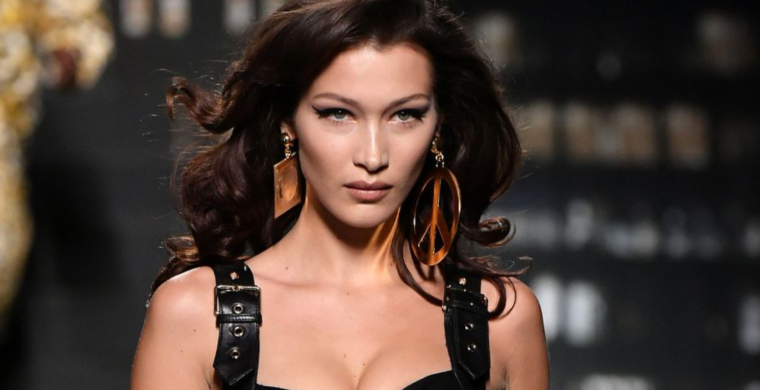 Bella Hadid Poses in Underwear, Knee-High Snakeskin Boots, & Nothing Else