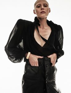 Blouse; skirt; and bracelet, all from Saint Laurent by Anthony Vaccarello.