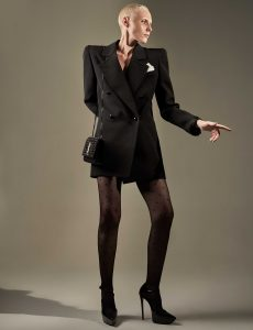 Blazer; bag; stockings; and heels, all from Saint Laurent by Anthony Vaccarello.