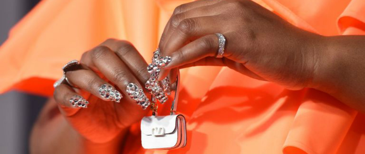 Lizzo carries the world's tiniest Valentino bag to the American Music Awards