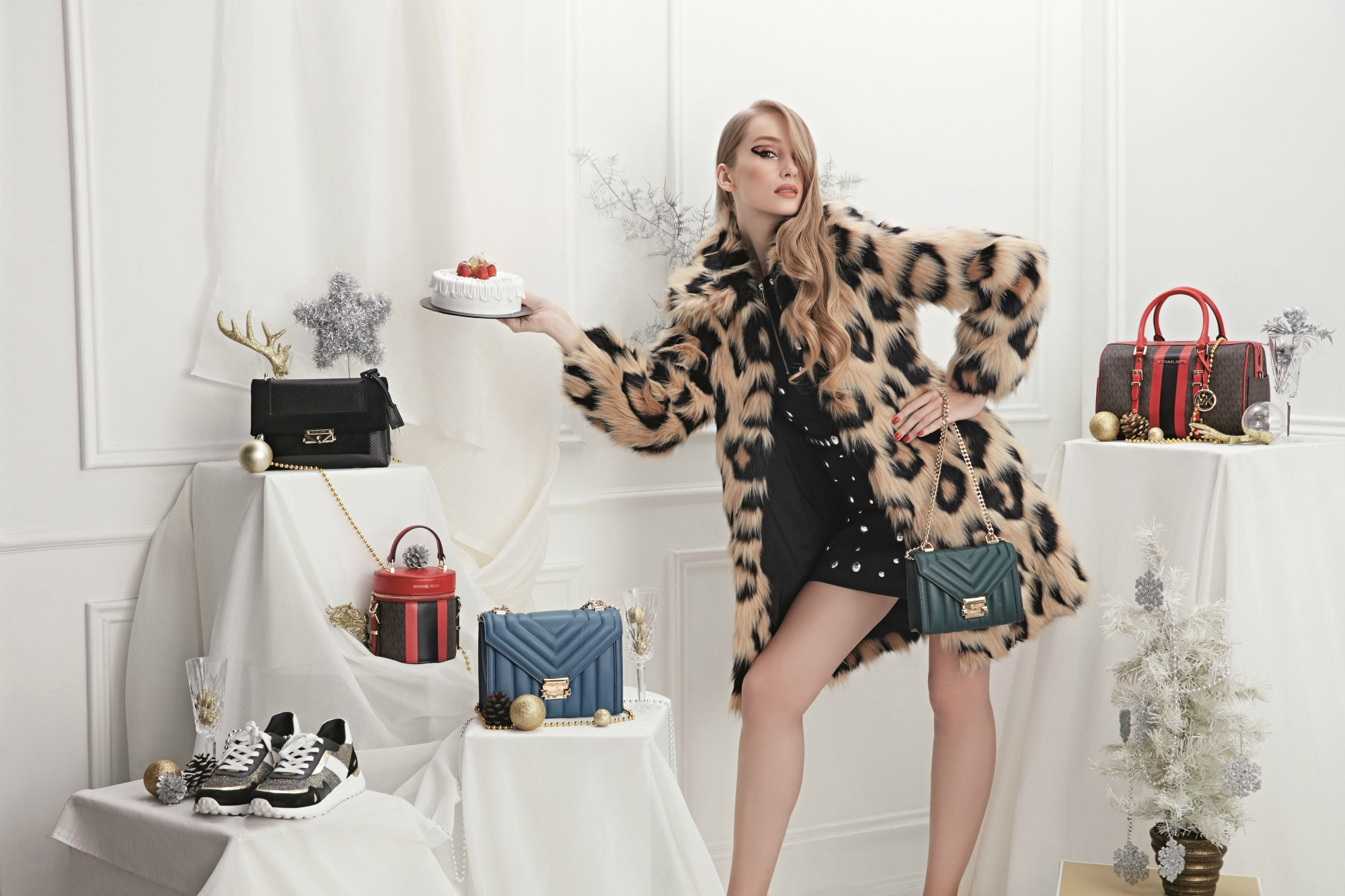 From left to right: Cece Medium Python-Embossed Leather and Suede Shoulder Bag; Bedford Travel Barrel Crossbody; Whitney Large Quilted Leather Convertible Shoulder Bag; Whitney Small Quilted Leather Convertible Shoulder Bag; and Bedford Travel Medium Logo Stripe Satchel; dress; coat; and shoes, all from Michael Kors.