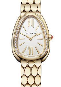 18 karat yellow gold case, 18 karat yellow gold bracelet, 18 karat yellow gold bezel set with diamonds, and a white silver opaline dial.