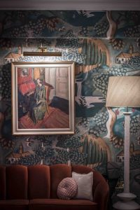 The sitting room at the hotel features custom illustrations of the Bloomsbury Set