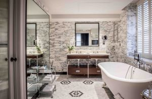 Awashed in natural light, The Bloomsbury's suites also feature marble floors and free-standing tub